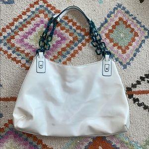 Chinese Laundry cream with turquoise handbag